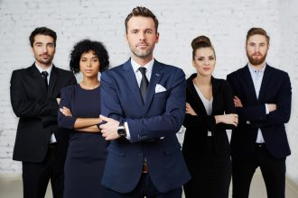 Group of perky lawyers, businesspeople standing together
